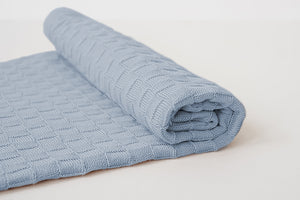American Made Organic Cotton Baby Blanket in Light Indigo Partially rolled up