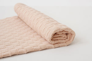 American Made Organic Cotton Baby Blanket in Peach Partially rolled up