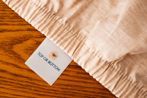Organic Cotton Fitted Sheet showing American Blossom Linens Label.