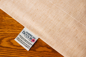 Organic Cotton Flat Sheet showing American Blossom Linens Label.