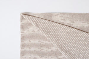 American Made Organic Beach Throw in Dove Grey folded at the corner.