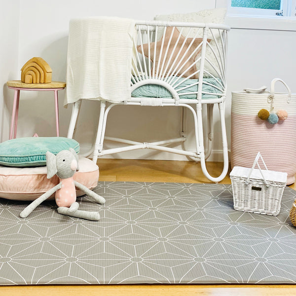 Medium dark grey scandi stars play mat (1m x 1.4m) alongside cot