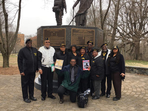 D. Marque Hall (kneeling in front) of representatives from the National Association of Black Veterans and Wilmington City Treasurer Velda Jones-Potter at the African American Congressional Medal of Honor Statue.