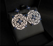 Circular evening earrings