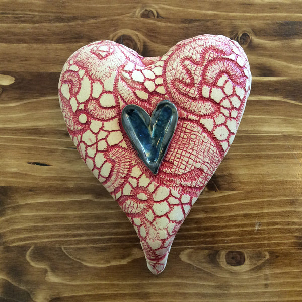 Pottery Patterned Wall Heart Red with Blue Glass