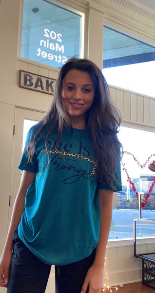 She is Strong Leopard Print Cross on Teal Christian T-Shirt