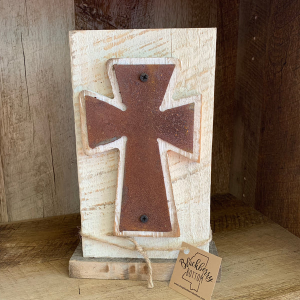 Rusted Metal Cross on Whitewashed Wood Block