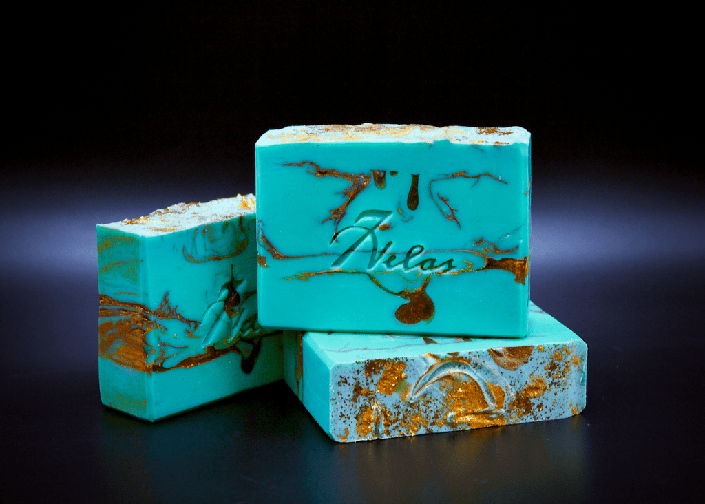 Handmade Artisan Soap Turquoise with gold and copper. Smells like Juniper Breeze