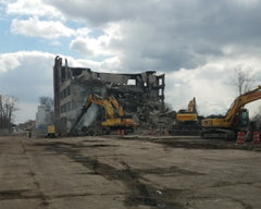 Demolition Crane Operators Demolish Unused Structures in Detroit, Michigan