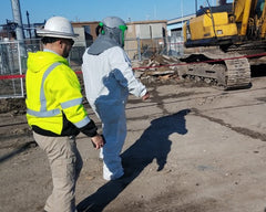 Demolition Crane Operator with supplied air respirator for asbestos abatement