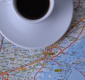 Espresso cup sitting on a map of Venice