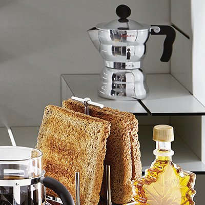 Alessi Moka - Stove-top Espresso Coffee Maker on a ledge with toast and syrup below