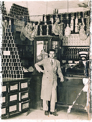 Caffe San Giusto Founder Libero Petronio in the 1950s standing in his shop