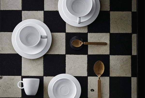 Alessi Bavera full table setting on a black and white checkerboard tablecloth