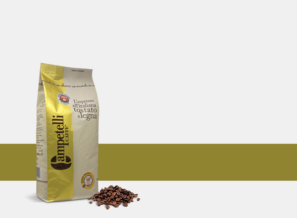 campetelli caffe 1K bag of beans product pic with a gold and cream colored bag and a pile of beans in front of the bag with a gold stripe behind it