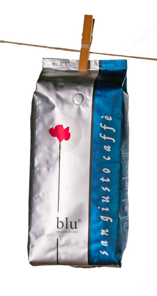 San Giusto Caffe packet of coffee beans 1K in blue and silver bag hanging on a clothesline