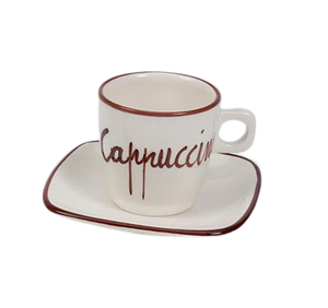 "white cappuccino cup with the word ""Cappuccino"" written on it sitting on a matching saucer with a brown stripe around the edges."