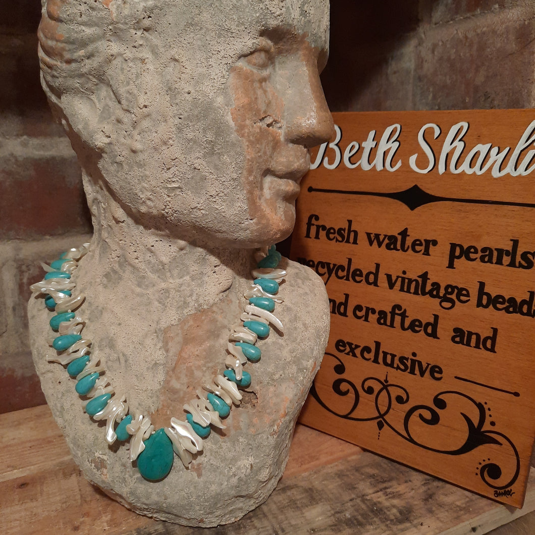 Turquoise and mother of pearl necklace.