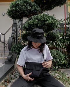Women streetwear fashion with black bucket cap in Singapore