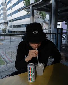 Men streetwear fashion with black bucket cap in Singapore