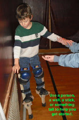 Use a wall, pole, or spotter when first learning to Stilt Walk