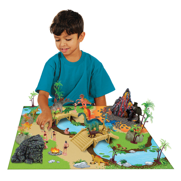 boy playing with his prehistoric playset