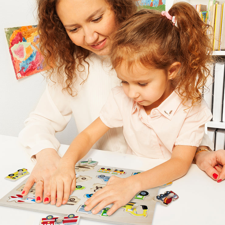 mom and daughter building the Jumbo People Movers Peg Puzzle