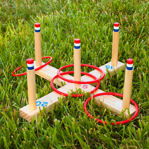 ring toss rings thrown over wooden pegs