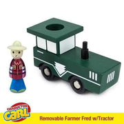 farmer fred figurine wearing a red shirt blue pants and a wide brimmed hat his green tractor is seen behind him
