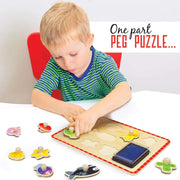 boy in green top playing with Professor Poplar Puzzle Stampers Marine Animals