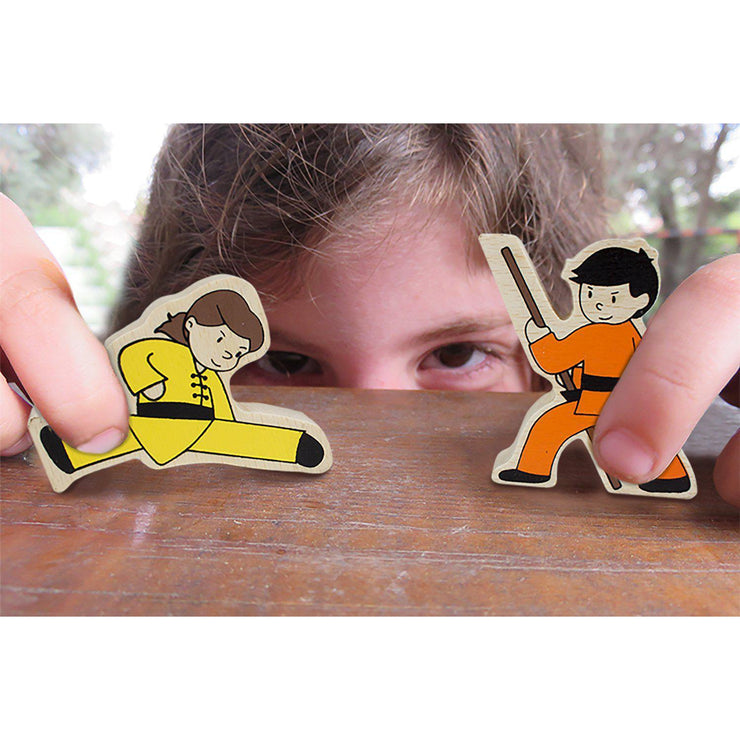 boy having a play fight with two of the Kung-Fu Stunt Stackers