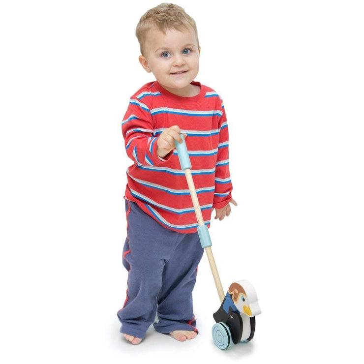 boy in stripy top playing with Radical Racers Madcap Penguin