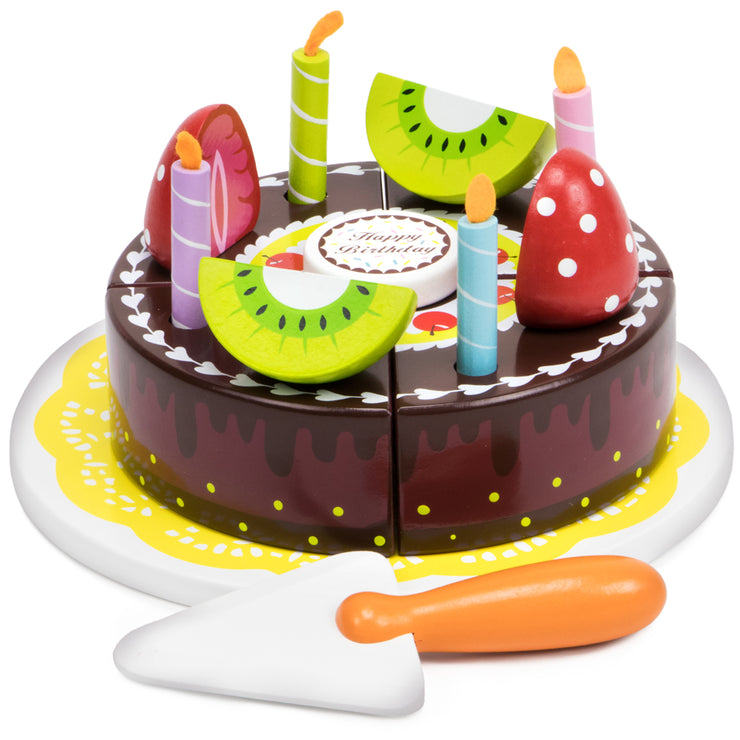 wood eats chocolate cake with fruit on top and server knife