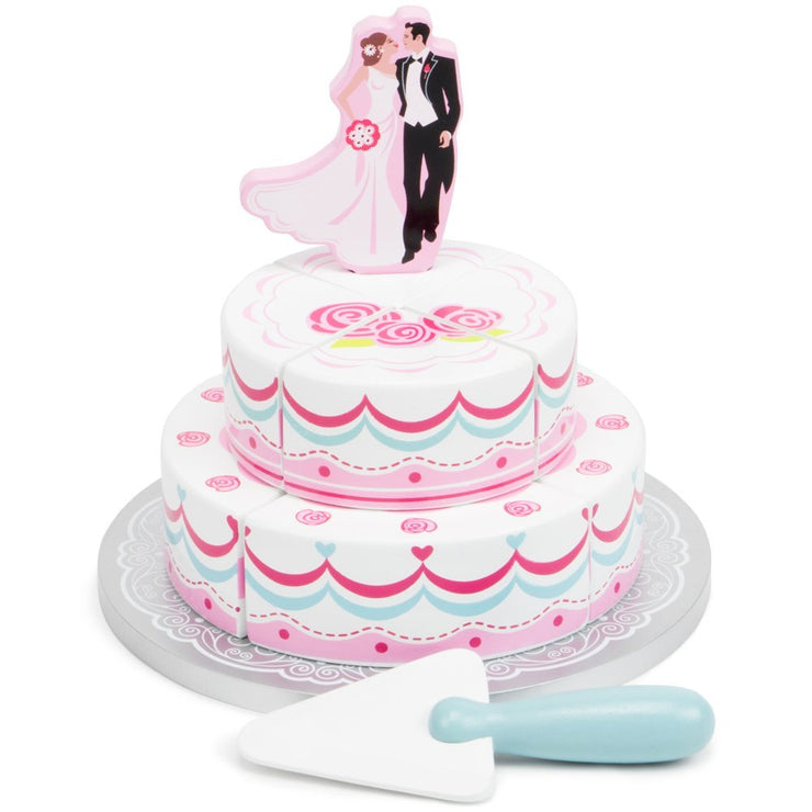 wood eats wedding cake bride and groom on top of the cake serving tool in front of the cake