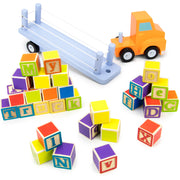 orange truck seperated from blue trailer alphabet blocks of varying colors packed in front