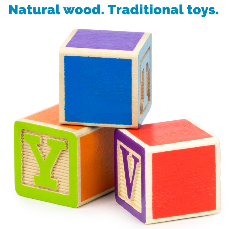 three blocks tiered with a heading reading natural wood traditional toys