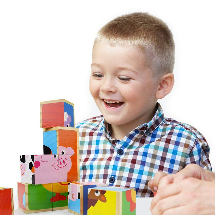 boy in checkered shirt laughing while play wit Barnyard Animal Block Puzzle