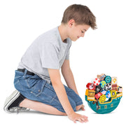 boy sitting in front of a successfully stacked stem toy pirate ship