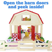 image of barn from the front animals before the barn in the barn and up in the loft