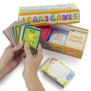 image of a hand holding a pack of stem cards with box packaging in the background