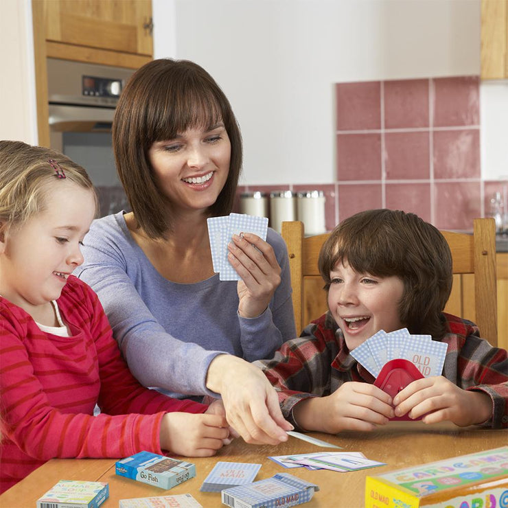 mom with two smiling children playing with one of the stem card games