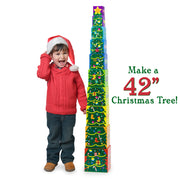 excited toddler standing next to the built up christmas tree text reading make a forty two inch christmas tree