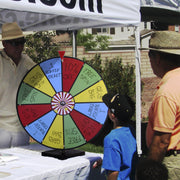 boy turning the color dry erase prize wheel at a fair
