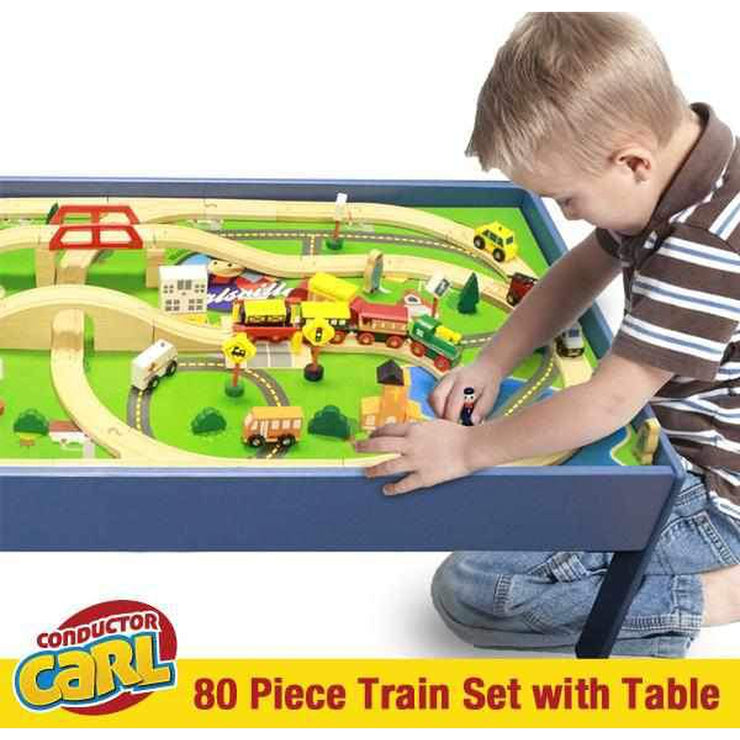 little boy shown playing with conductor carl figurine around a built train track upon the table
