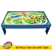view showing a blue table with a built train track having bridges trains cars a building and signs