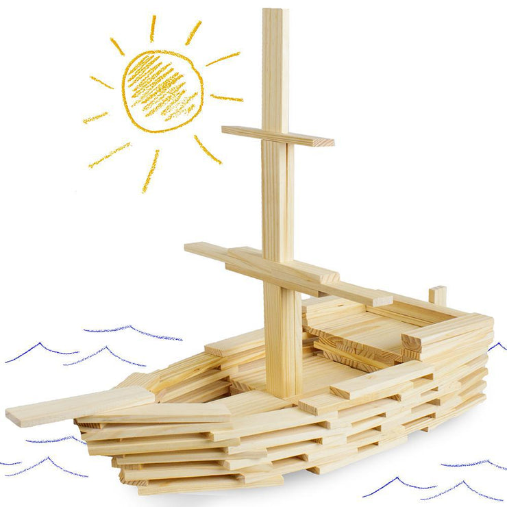constructed model boat placed on a page that has the sea and sun drawn