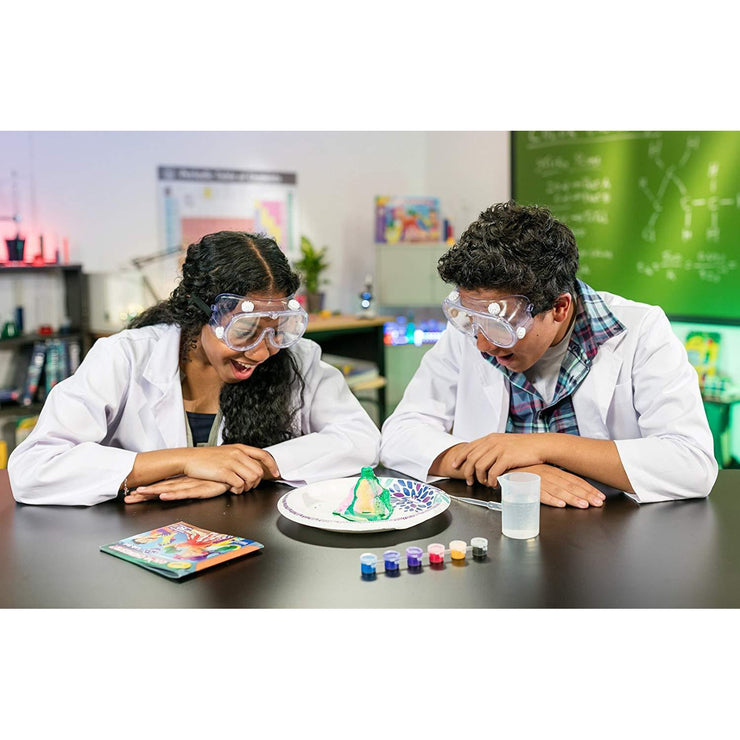 teens in white coats playing with crayola chemistry set