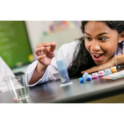 girl about to see reaction with chemistry experiment