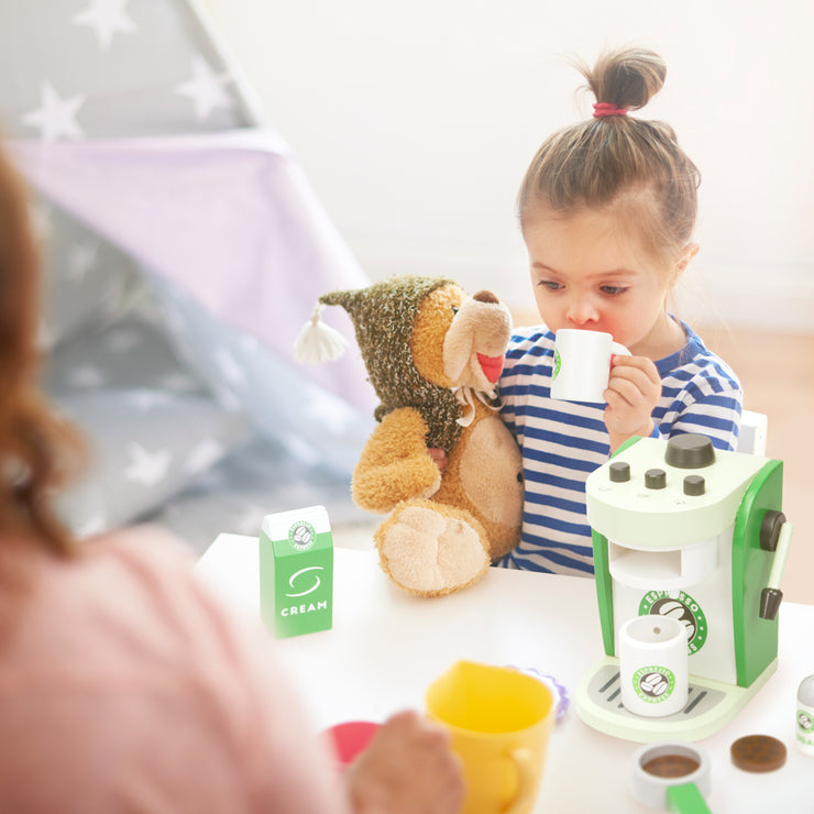 little girl enjoying her wood eats creative play espresso maker