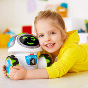 smiling girl in a yellow shirt holding a winking Movi robot